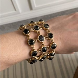 Cache gold and pewter colored bracelet